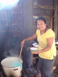 Anita serving up atole