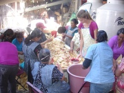 Sisters in Christ helping to prepare a feast for the fiesta